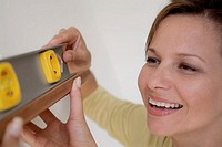 Close-up of a woman holding a spirit level