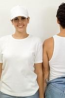 Two people standing shoulder to shoulder