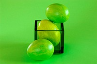 Green Easter eggs in glass