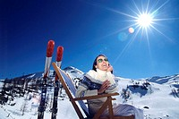 Woman relaxing in alps, winter