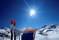 Person sitting in deckchair in alps, winter