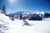 Man skiing in alps, side view