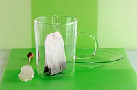 Empty tea glass with tea bag and rock candy