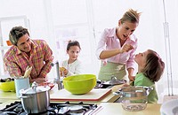 Parents with children (4-7) in kitchen
