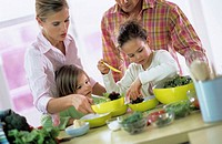 Family in kitchen preparing salad, children (4-7)