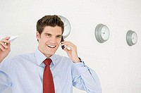 Businessman getting good news on the telephone
