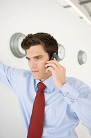 Businessman using cellular telephone