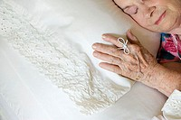 Elderly woman sleeping with string on her finger