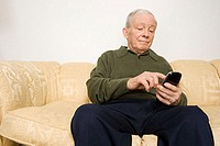 Elderly man using remote control