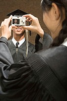 Graduates taking photographs