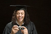 Female graduate looking at photographs