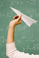 Student about to throw a paper aeroplane