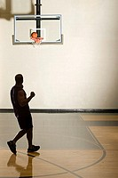 Man playing basketball