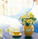 flowers with small items and interior objects