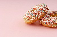 Pair of donuts with sprinkles