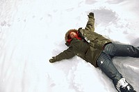 Man making a snow angel