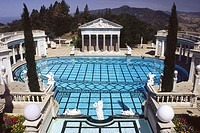 The Neptune Pool flanked by colonnades and the facade of a Greek temple in the grounds of Hearst Castle, San Simeon, California, United States of Amer...