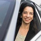 Mature businesswoman smiling from inside a car