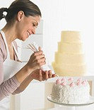 Woman icing a cake