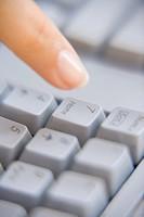 Woman pressing Î7´ key on a keyboard