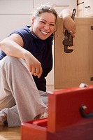 Young woman working on plumbing