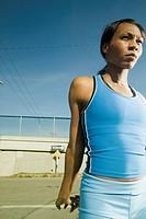 Female athlete stretching in urban surroundings