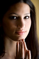 Portrait of a young woman with her hand on her chin (thumbnail)