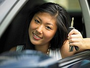 Portrait of teenage girl with keys in car