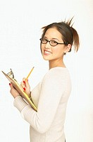 Young businesswoman smiling for the camera while holding a notepad