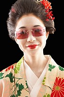 Asian woman in ethnic clothes wearing sunglasses