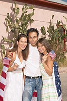 Family draped in an American flag