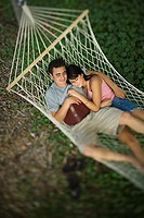 High angle view of a young couple sleeping in a hammock (thumbnail)