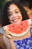 Portrait of a girl holding a watermelon smiling (thumbnail)