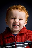 Portrait of a baby boy making a face (thumbnail)