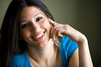 Close-up of a young woman talking on the mobile phone (thumbnail)