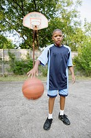 Young boy dribbling basketball