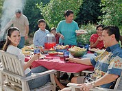 Family eating at a barbecue