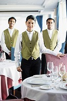 Waiters smiling for the camera in restaurant