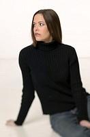 Woman with dark hair and brown eyes, posing in studio, portrait