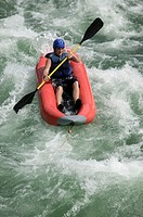 Man kayaking on river, elevated view