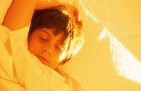 Boy (8-9), sleeping in bed, close-up