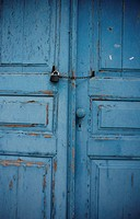 Old blue doors with flaking paint, Greece, (Mid section)