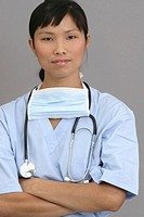 Young female nurse with arms crossed, portrait