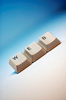 Close-up of computer keys spelling the word web