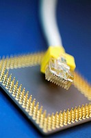 Close-up of a computer chip with a network cable