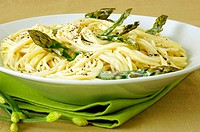 Close-up of a bowl of spaghetti with asparagus