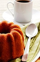 Close-up of a cake and a cup of coffee