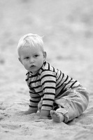 Portrait of a little boy playing on the beach