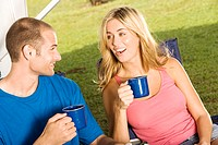 Close-up of a young couple holding coffee cups