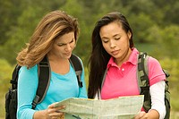 Close-up of two young women looking at a map